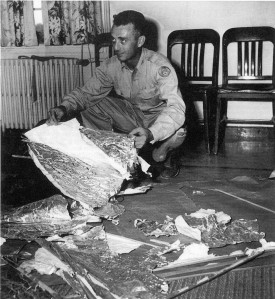 DENVER - UNDATED: Major Jesse Marcel from the Roswell Army Air Field with debris found 75 miles north west of Roswell, NM, in June 1947. The debris has been identified as that of a radar target. The Air Force released a report on 24 June debunking reports of a UFO crash near Roswell, NM, in 1947. (Photo by: UNITED STATES AIR FORCE/AFP/Getty Images)