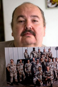 K.M. CANNON/REVIEW-JOURNAL Former Area 51 worker Fred Dunham holds a 1988 photo of him (standing at left) in his Las Vegas home Wednesday, Aug. 13, 2008. Due to Dunham's case, former workers or their survivors stand to receive about $150,000 in compensation plus money for medical costs for illness linked to their exposure to toxic or radioactive materials at the classified installation. Area 51 is located on the Groom Lake bed near the Nevada Test Site's northeast corner 90 miles northwest of Las Vegas.